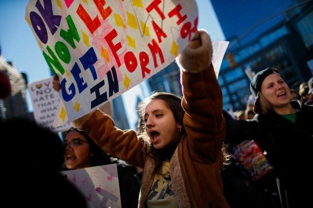 """People take part in the """"Not My President's Day"""" rally in Manhattan, New York, US February 20, 2017. Credit: Reuters"""