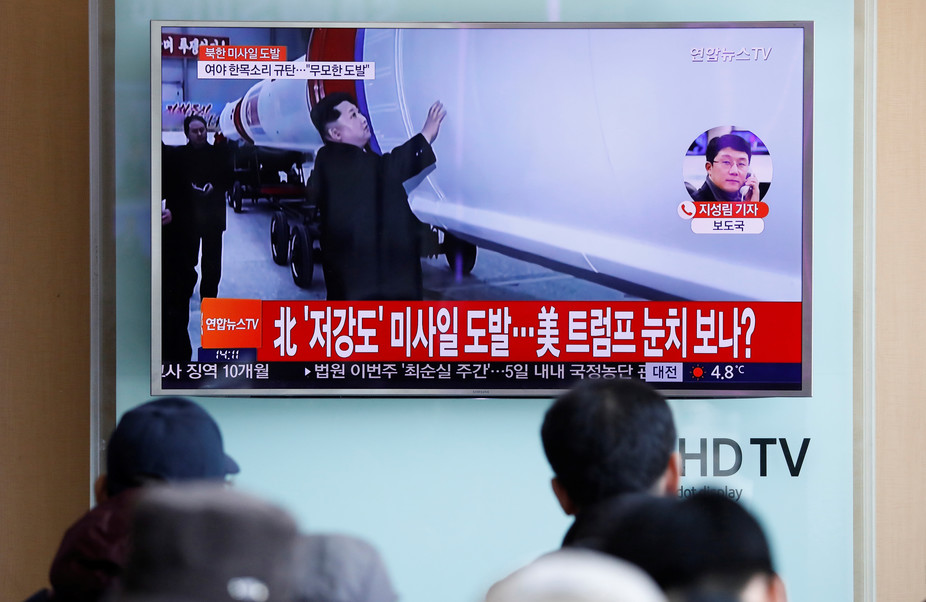 onlookers watch news of another North Korean ballistic missile test