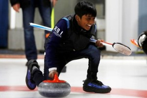 "A refugee from Sri Lanka, Arun Daniel, learns the sport of curling at the Royal Canadian Curling Club during an event put on by the ""Together Project"", in Toronto, March 15, 2017. Credit: Reuters/Mark Blinch -A refugee from Sri Lanka, Arun Daniel, learns the sport of curling at the Royal Canadian Curling Club during an event put on by the ""Together Project"", in Toronto, March 15, 2017. Credit: Reuters/Mark Blinch -"