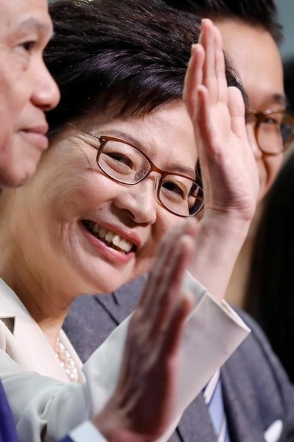 Carrie Lam waves during news conference after she won the election for Hong Kong's chief executive in Hong Kong, China March 26, 2017. Credit: Reuters