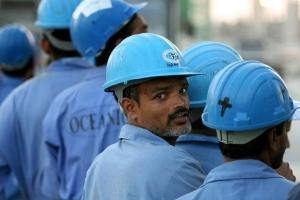 Indian workers line up to board a bus after a day's work in Dubai, November 18, 2005. Credit: Reuters