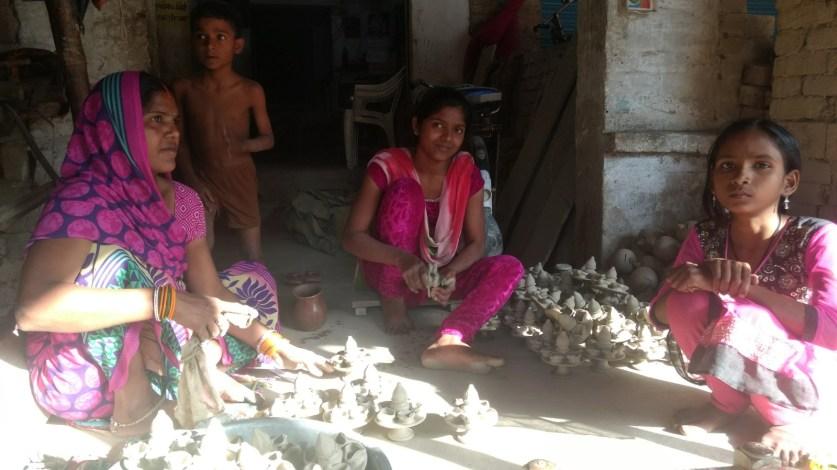 Prema Devi with her daughters making diyas in Nizamabad. Credit: Titash Sen