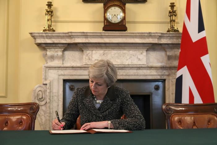 British Prime Minister Theresa May in the cabinet office signs the official letter to European Council President Donald Tusk invoking Article 50 and the United Kingdom's intention to leave the EU on March 28, 2017 in London, England. After holding a referendum in June 2016 the United Kingdom voted to leave the European Union, the signing of Article 50 now officially triggers that process. Credit: Reuters/Christopher Furlong/Pool