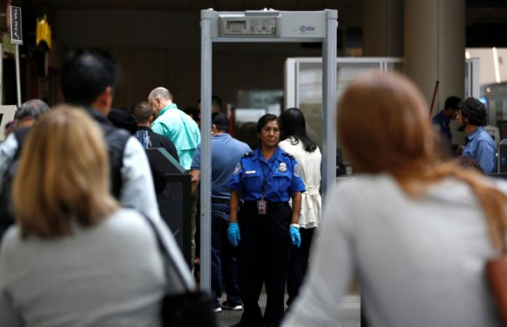 Travelers stand in line to go through Transportation Security Administration (TSA) check-points at Los Angeles International Airport in Los Angeles, US, May 31, 2016. Credit: Reuters/Mario Anzuoni