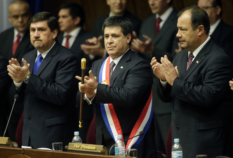 Both President Horacio Cartes (centre) and Blas Llano (left) are running for president. Credit: Jorge Adorno/Reuter