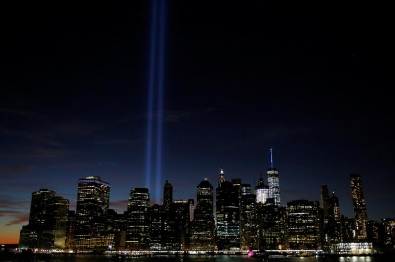 FILE PHOTO: The Tribute in Light shines on the 15th anniversary of the 9/11 attacks in Manhattan, New York, U.S., September 11, 2016. REUTERS/Andrew Kelly