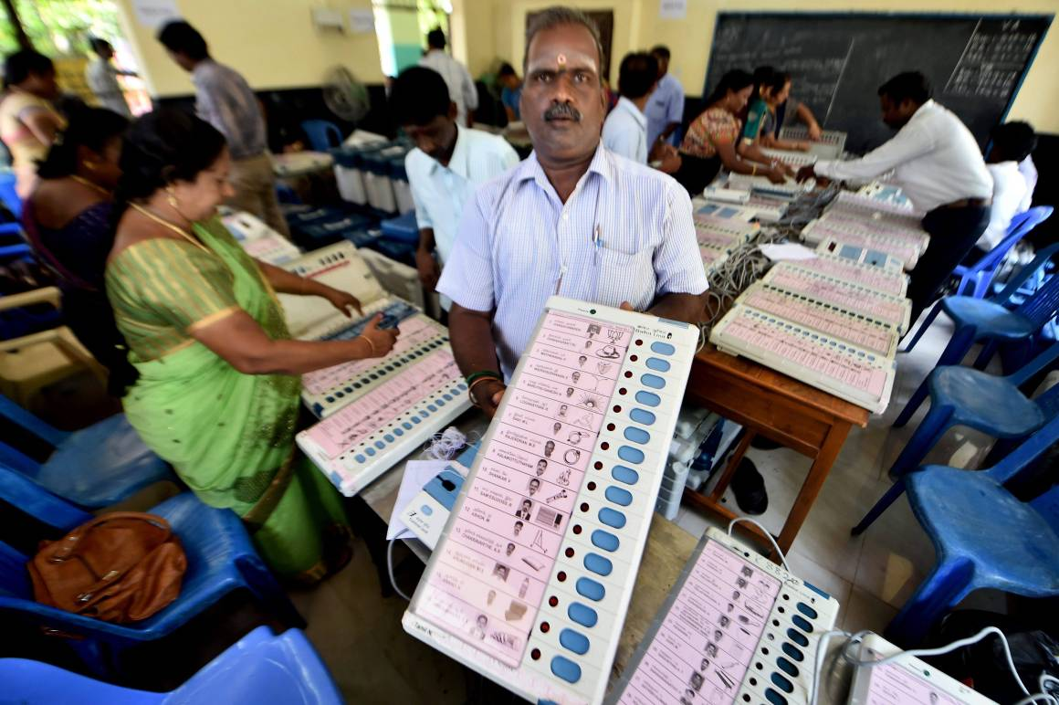 Workers readying EVMs for the R.K. Nagar by-poll in Chennai on April 5, 2017. Credit:.PTI