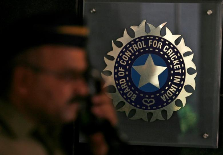 A policeman walks past a logo of the Board of Control for Cricket in India (BCCI) during a governing council meeting of the Indian Premier League (IPL) at BCCI headquarters in Mumbai April 26, 2010. Credit: Reuters/Arko Datta/Files