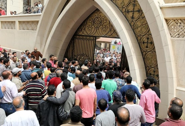 Egyptians gather in front of a Coptic church that was bombed on Sunday in Tanta, Egypt, April 9, 2017. Credit: Reuters
