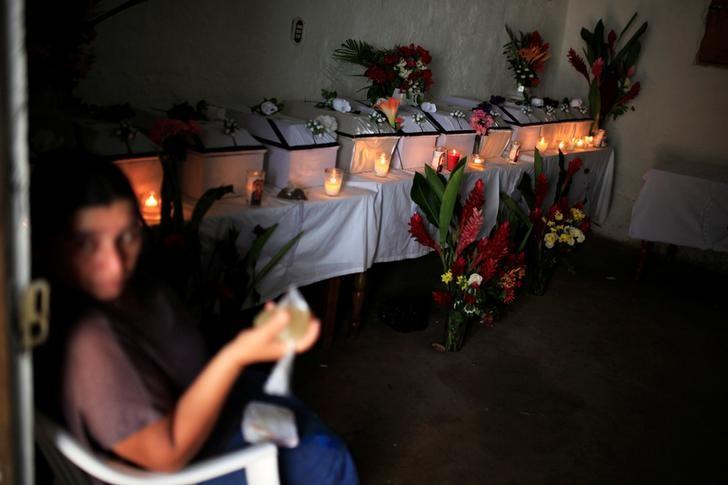A woman attends the wake of people who died in the EL Mozote Massacre, in the village of La Joya, Meanguera, El Salvador, December 11, 2016. Credit: Reuters/Jose Cabezas
