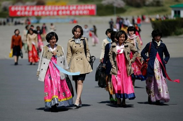 Women wear traditional clothes as North Korea prepares to mark Saturday's 105th anniversary of the birth of Kim Il-sung, North Korea's founding father and grandfather of the current ruler, in central Pyongyang, North Korea April 12, 2017. Credit: Reuters/Damir Sagolj