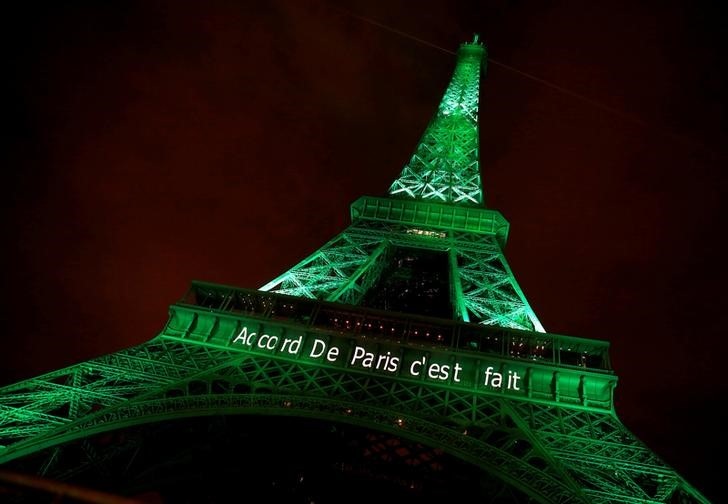 "The Eiffel tower is illuminated in green with the words ""Paris Agreement is Done"", to celebrate the Paris UN COP21 Climate Change agreement in Paris, France, November 4, 2016. Credit: Reuters/Jacky Naegelen/Files"