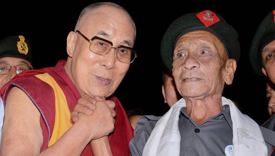 The Dalai Lama with the retired jawan of Assam Rifles, Naren Das, in Guwahati. Credit: PTI