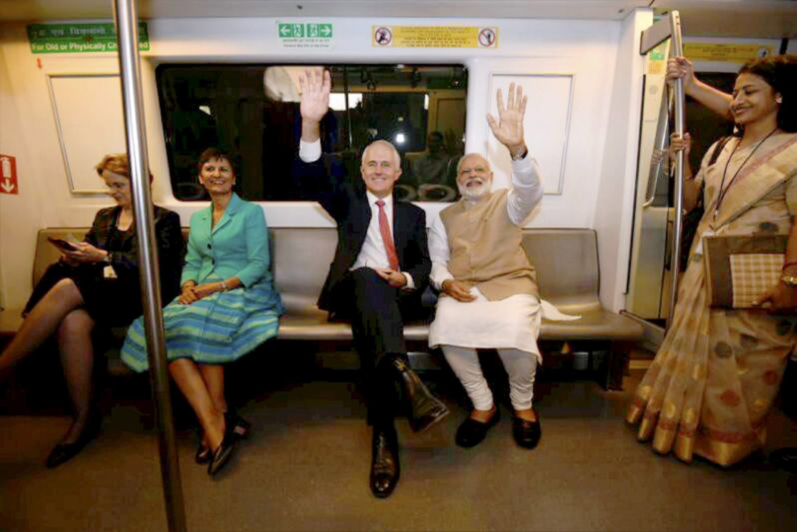 Prime Minister Narerndra Modi with his Australian counterpart Malcolm Turnbull waves while travelling in a metro train in New Delhi on Monday. Credit: PTI
