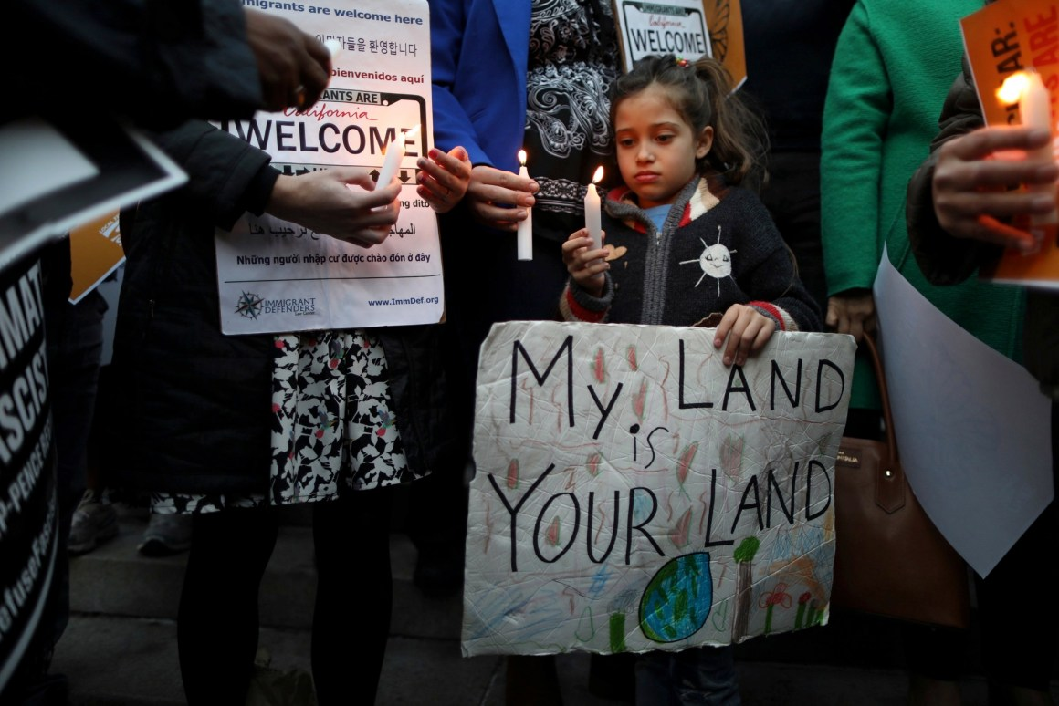 Maya Casillas, 7, attends a vigil in response to President Donald Trump's executive orders relating to immigration, in Los Angeles, California, U.S., January 25, 2017. Credit: Reuters/Lucy Nicholson
