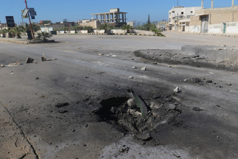 A crater is seen at the site of an airstrike, after what rescue workers described as a suspected gas attack in the town of Khan Sheikhoun in rebel-held Idlib, Syria April 4, 2017. Credit: Reuters/Ammar Abdullah