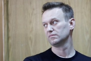Russian opposition leader Alexei Navalny attends a hearing after being detained at the protest against corruption and demanding the resignation of Prime Minister Dmitry Medvedev, at the Tverskoi court in Moscow, Russia March 27, 2017. Credit: Reuters/Tatyana Makeyeva/File Photo