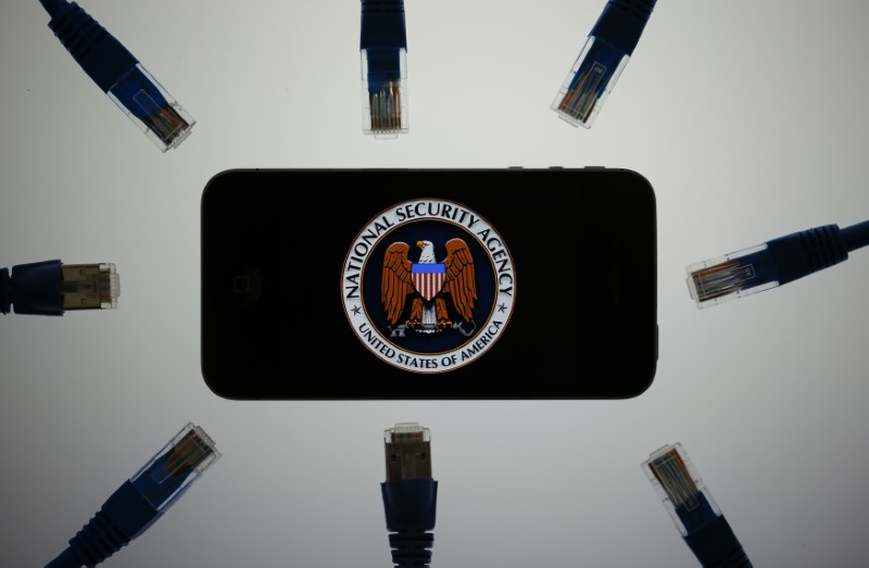 An illustration picture shows the logo of the US National Security Agency on the display of an iPhone in Berlin, June 7, 2013. Credit: Reuters/Pawel Kopczynski