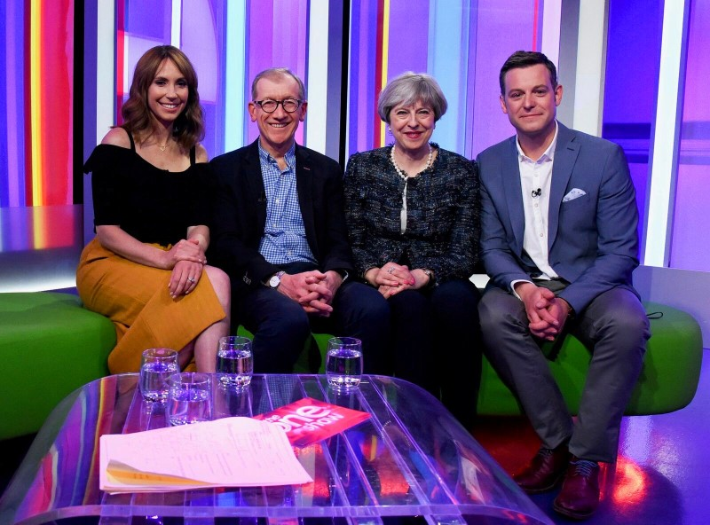 Britain's Prime Minister Theresa May and her husband Philip sit with BBC Television's One Show presenters Matt Baker and Alex Jones at the BBC in London, Britain May 9, 2017. Credit: Picture issued by the Conservative Party/Handout via Reuters.
