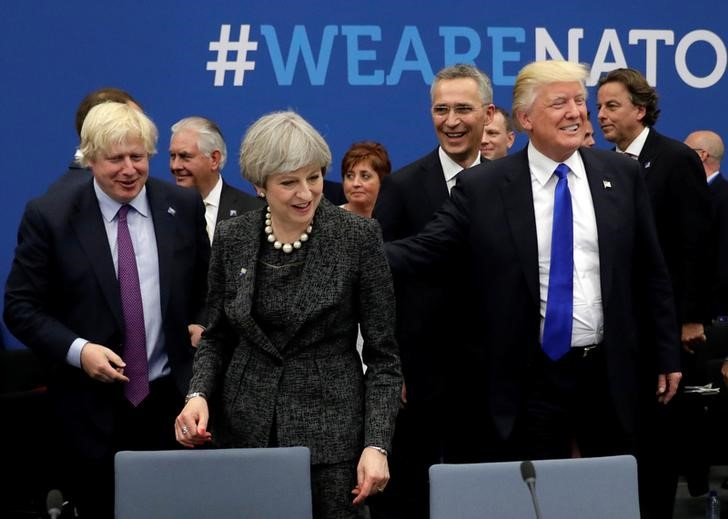 Britain's Foreign Secretary Boris Johnson (L), US President Donald Trump (R) and Britain's Prime Minister Theresa May (C) attend a working dinner meeting at the NATO headquarters during a NATO summit of heads of state and government in Brussels, Belgium, May 25, 2017. Credit: Reuters/Matt Dunham/Pool
