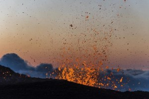 Molten lava erupts from the Piton de la Fournaise, one of the world's most active volcanoes, at dawn on the French Indian Ocean Reunion Island, August 25, 2015. The eruption which started on Monday, is the fourth one this year for the Piton de la Fournaise, sending hot jets of molten lava spewing up from the peak. Credit: Reuters/Gilles Adt