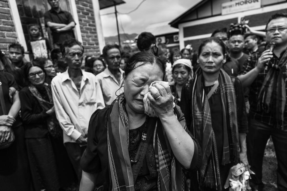 A mother mourned as the coffins were taken away to the Lamka Public Ground for the public to pay their last respects to the dead. Credit: Vivek Singh