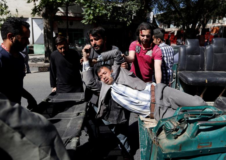Men move an injured man to a hospital after a blast in Kabul, Afghanistan May 31, 2017. Credit: Reuters/Mohammad Ismail