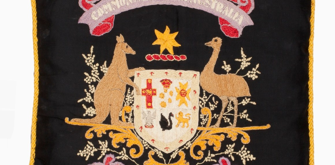 Part of a black cotton cushion cover depicting the Australian coat of arms embroidered by Lance Corporal Alfred Briggs (Albert Biggs), 20 Battalion, AIF. Credit: Australian War Memorial/The Conversation