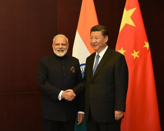 Prime Minister Narendra Modi (left) and China's Xi Jinping in Asthana. Credit: Reuters
