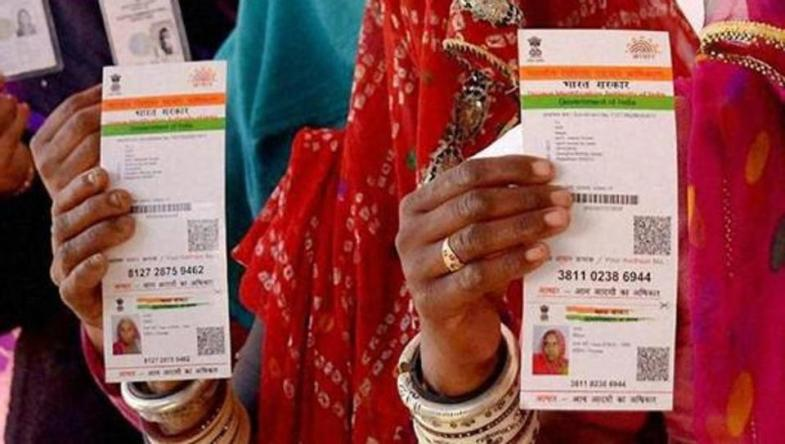 File photo of women in Ajmer holding up their Aadhaar cards. Credit: PTI