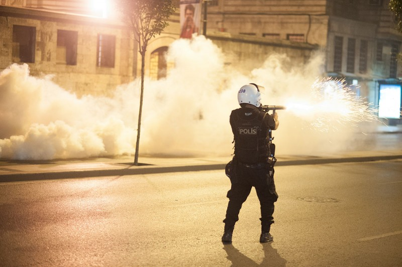A police officer fires teargas in Istanbul during the Gezi Park protests, June 2013. Credit: Mstyslav Chernov via Wikimedia
