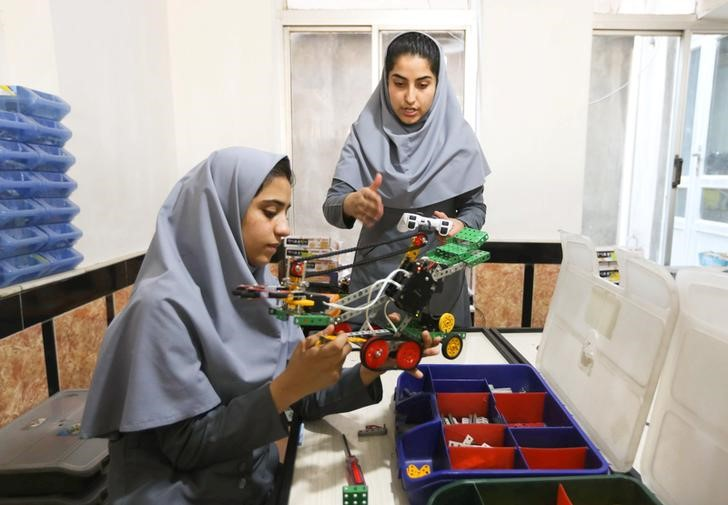 Members of Afghan robotics girls team which was denied entry into the United States for a competition, work on their robots in Herat province, Afghanistan July 4, 2017. Credit: Reuters/Mohammad Shoib