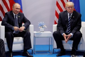 US President Donald Trump meets with Russian President Vladimir Putin during their bilateral meeting at the G20 summit in Hamburg, Germany, July 7, 2017. Credit: Reuters/Carlos Barria