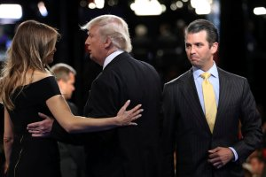 Donald Trump Jr. (R) watches as his father, Republican presidential nominee Donald Trump, hugs his wife Melania after his debate against Democratic nominee Hillary Clinton at Hofstra University in Hempstead, New York, US September 26, 2016. Credit: Reuters/Joe Raedle