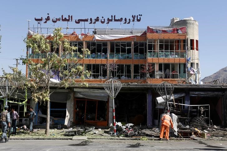 An Afghan municipality worker sweeps a road at site of a suicide attack in Kabul, Afghanistan, July 24, 2017. Credit: Reuters/Omar Sobhani