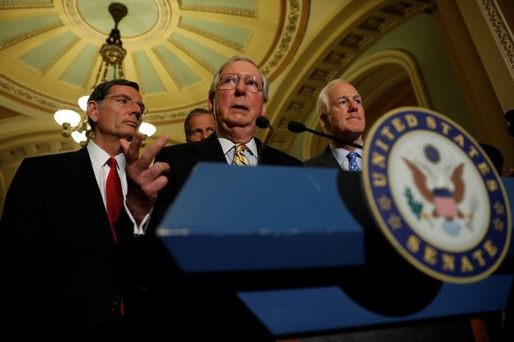 Senate majority leader Mitch McConnell, accompanied by senator John Cornyn (R-TX) and senator John Barrasso (R-WY), speaks with reporters following the successful vote to open debate on a health care bill on Capitol Hill in Washington, US, July 25, 2017. Credit: Reuters/Aaron P. Bernstein