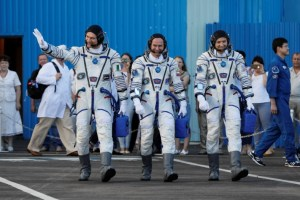 The International Space Station (ISS) crew members (L to R) Paolo Nespoli of Italy, Sergey Ryazanskiy of Russia and Randy Bresnik of the US walk after donning space suits, shortly before their launch at the Baikonur Cosmodrome, Kazakhstan July 28, 2017. Credit: Reuters/Shamil Zhumatov