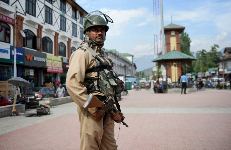 Srinagar: A security person stands guard at Lal Chowk in Srinagar on Thursday. Authorities beefed up security in Kashmir valley ahead of the first death anniversary of slain Hizbul Mujahideen commander Burhan Wani falling on upcoming Saturday. Credit: PTi