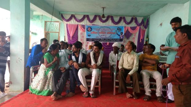 Laxmiben (left, green sari) along with Jignesh Mevani and core team member Subodh Parmar during a public Azadi Kooch meeting.