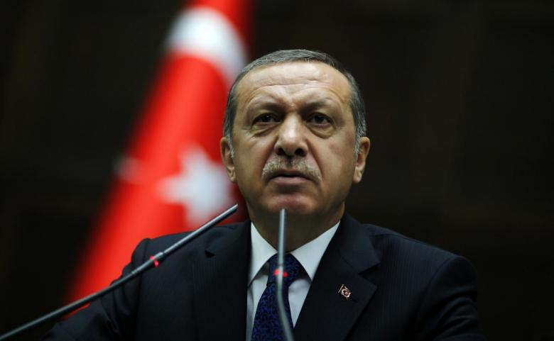Turkey's Prime Minister Tayyip Erdogan addresses members of parliament from his ruling AK Party during a meeting at the Turkish parliament in Ankara June 3, 2014. Credit: Reuters/Umit Bektas