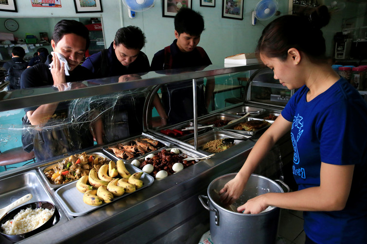 Small businesses, like this restaurant in the Philippines, should be encouraged to take part in the UBI scheme. Credit: Reuters/Romeo Ranoco