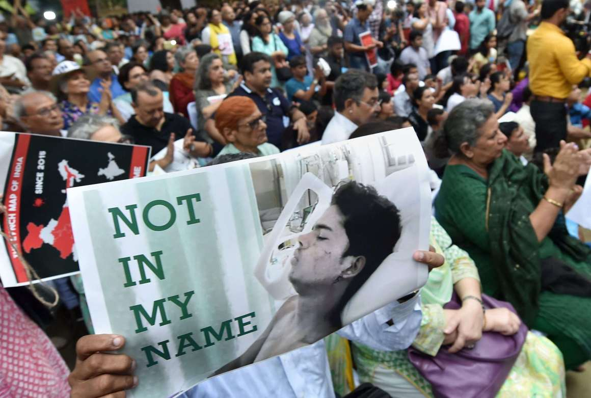 "Citizens hold placards during a silent protest "" Not in My Name "" against the targeted lynching, at Jantar Mantar in New Delhi on Wednesday. Credit: PTI/Shahbaz Khan"