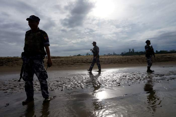 FILE PHOTO: A Myanmar border guard police officers stand guard in Buthidaung, northern Rakhine state, Myanmar, July 13, 2017. Credit: Reuters/Simon Lewis/File Photo