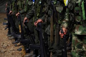 FARC members stand during a formation in a camp before moving to the transitional zone of Pueblo Nuevo, at the Los Robles FARC camp, Colombia, January 25, 2017. Credit: Reuters/Federico Rios