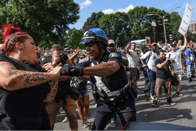 Counter protesters clash with Boston Police outside of the Boston Commons and the Boston Free Speech Rally in Boston, Massachusetts, U.S., August 19, 2017.