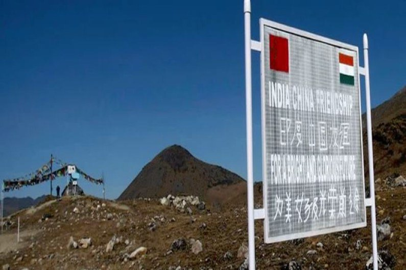 A signboard is seen from the Indian side of the Indo-China border at Bumla. Credit: Reuters