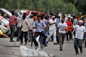 Protestors react during violence in Panchkula, India, August 25, 2017. Credit: Reuters/Cathal McNaughton