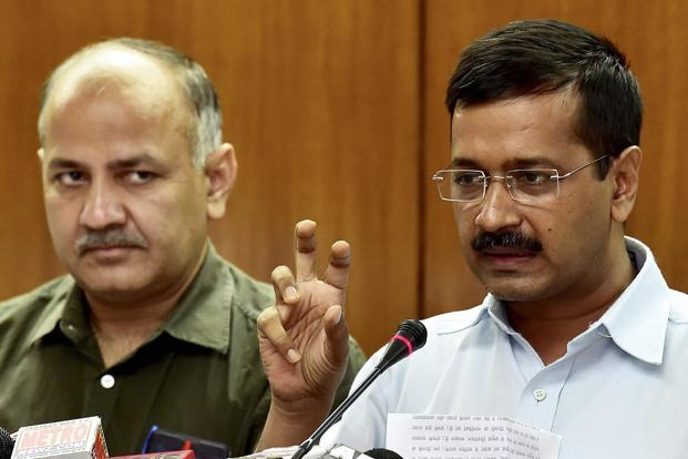 Delhi chief minister Arvind Kejriwal with his deputy and finance minister Manish Sisodia. Credit: PTI