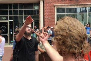 Neo-Nazis stand off with anti-racist protesters in Charlottesville. Credit: Flickr/Evan Nesterak