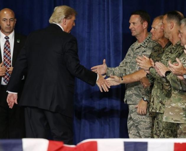 US President Trump shakes hands with officers after announcing his new policy for the war in Afghanistan. Credit: Reuters